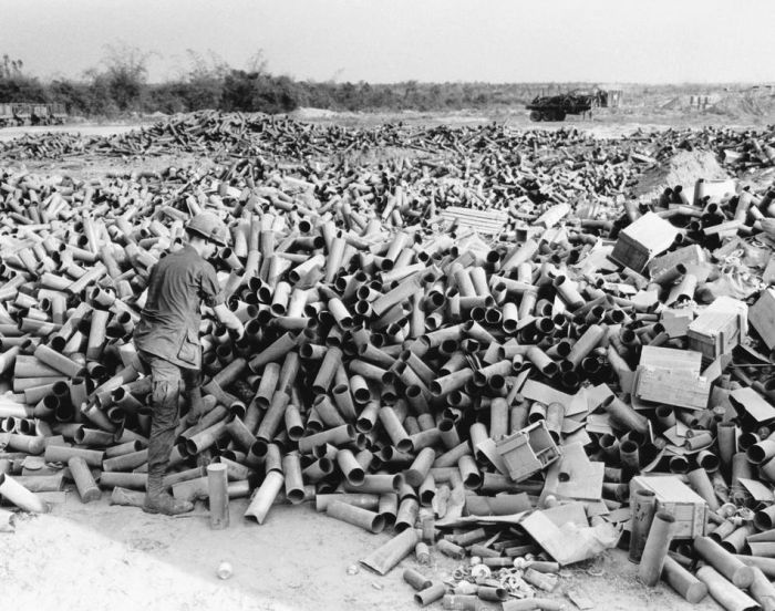 Empty artillery cartridges pile up at the artillery base at Soui Da, some 60 miles northwest of Saigon, at the southern edge of War Zone C, on March 8, 1967. (AP Photo/Horst Faas)