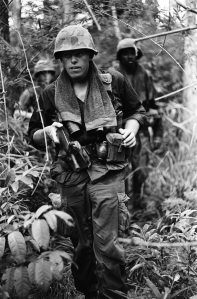 A-file-of-soldiers-on-a-routine-jungle-patrol.-Haughey-says-most-soldiers-wore-towels-around-their-necks-like-this-one-did-to-help-combat-sweat-in-the-jungle-heat.-Names-date-and-location-unknown