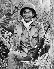 Vietnamese Soldier Smiling and Making the Peace Sign