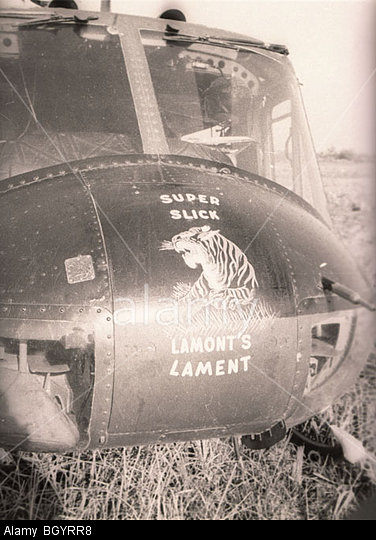 "BGYRR8 A Huey helicopter of the 121st AHC in Soc Trang, Vietnam, has the words, ""Super Slick,"" and, ""Lamont's Lament,"" painted nose art. Image shot 1967. Exact date unknown."
