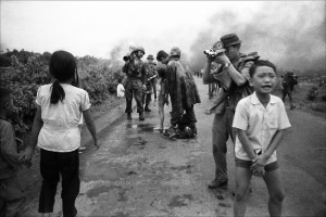 Journalists pour water over the burns of 9 year old Pham Thi Kim Phuc (center) who was injured in the accidental napalm bombing during a battle in Trang Bang. The iconic image by Nick Ut of Kim Phuc running was taken moments before this one. Trang Bang, South Vietnam, June 8, 1972