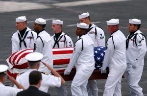 050716-N-0555B-033 San Diego (July 16, 2005) - Pallbearers of the Ceremonial Honor Guard carry the casket of retired Vice Adm. James B. Stockdale during a memorial service held aboard the Nimitz-class aircraft carrier USS Ronald Reagan (CVN 76). Hundreds of friends, family members and shipmates gathered to remember the former prisoner of war and Congressional Medal of Honor recipient who passed away July 5 in Coronado, Calif. U.S. Navy photo by Photographer's Mate Airman Apprentice Christopher D. Blachly (RELEASED)