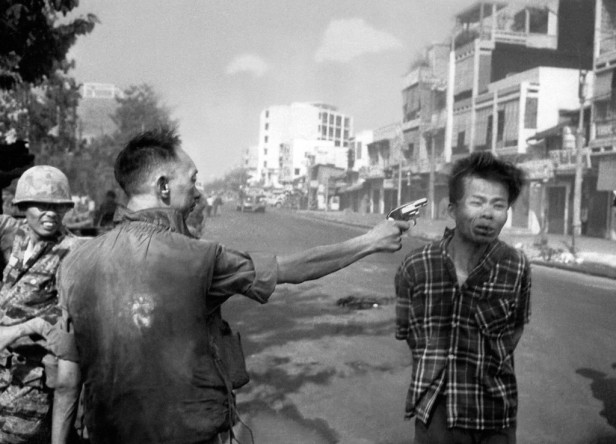 South Vietnamese Gen. Nguyen Ngoc Loan, chief of the national police, fires his pistol into the head of suspected Viet Cong officer Nguyen Van Lem, also known as Bay Lop, on a Saigon street, early in the Tet Offensive on Feb. 1, 1968. (AP Photo/Eddie Adams)