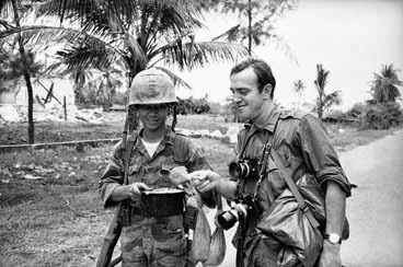 War correspondent Peter Arnett talking with a soldier in South Vietnam Oct. 1965. (AP Photo)
