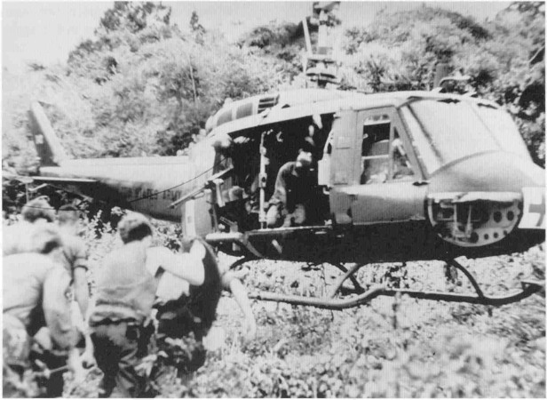 Lieutenant Tuell and Capt. Howard Elliot pilot a helicopter in Dustoff operation, May 1970
