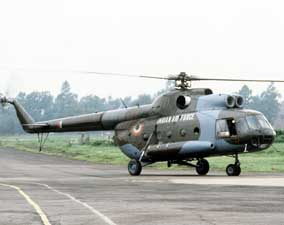 An Indian air force Mi-8 Hip helicopter rolls along a taxiway at an airport in Bangladesh. Indian, the U.S. and nations are sending aid to Bangladesh in response to the severe flooding in that country.