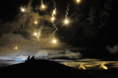 Participants in the Department of the Army Best Warrior Competition fire at targets as the night sky is illumintated with simulated munitions, adding a breath of realism to the night fire event. The competition was held at Sept. 27-Oct. 2 at Fort Lee, Va. (photo by T. Anthony Bell)