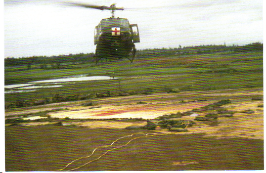 A Dust Off helicopter landing with a load of wounded at the LZ Hawk Hill aid station pad in early 1970. (Photo by the author.)