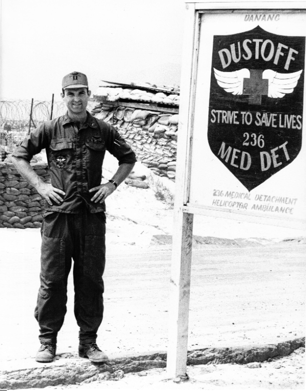 The author standing beside a facsimile of their unit patch outside their orderly room on 7 Mar 70, after being promoted to unit commander at Red Beach in Da Nang. (Photo courtesy of the author.)